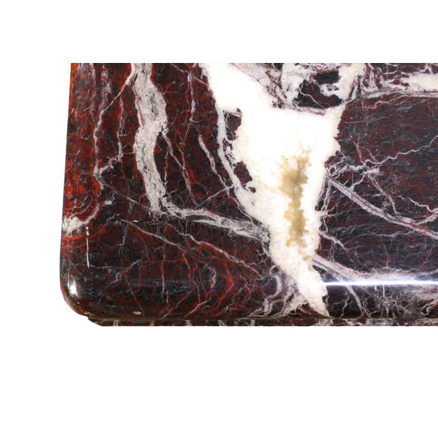 This natural minimalistic hall console is made of pure red and white veined black Italian marble. The natural variation is...