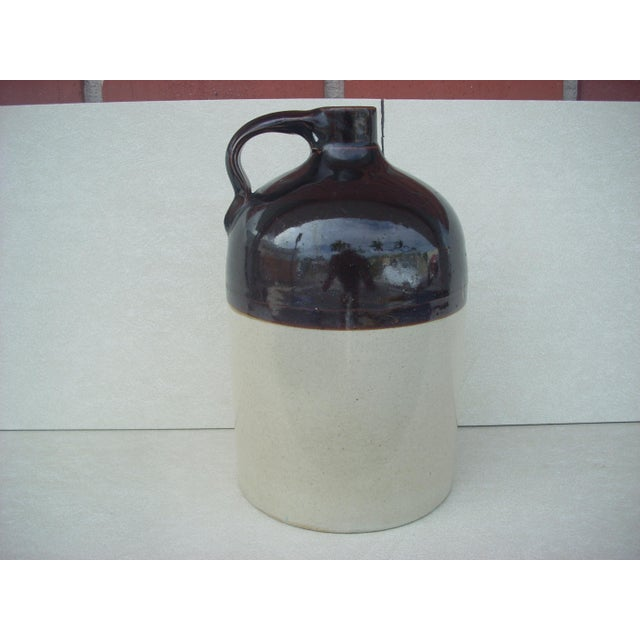 "Classic ""little brown jug""; moonshine or bath tub gin anyone? dark brown glaze on upper third, gray glaze on the lower..."