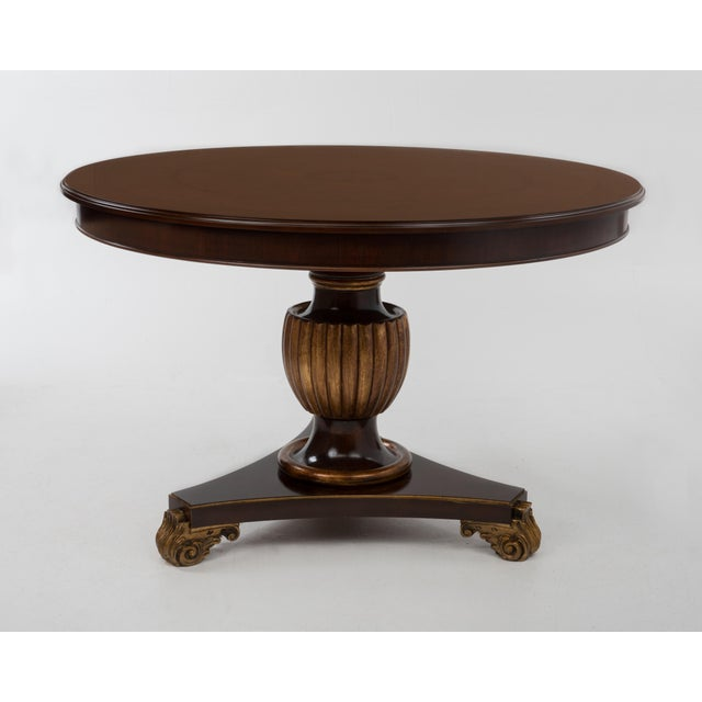 A very nice pedestal base center table made in Italy in the 1970s. Very well made, mahogany and burl with gilt details.