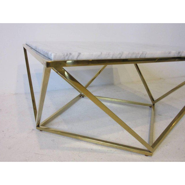 A square polished brass framed coffee table with a white and grey veined Italian Carrara marble-top in the manner of Milo...