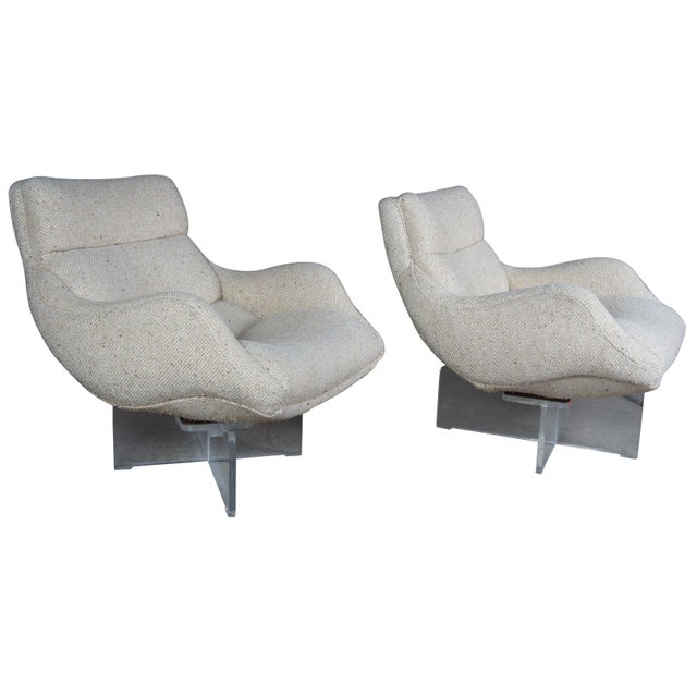 """Vladimir Kagan Cosmos lounge chairs. Features a sculptural original wool upholstered seat over crossform lucite base,..."
