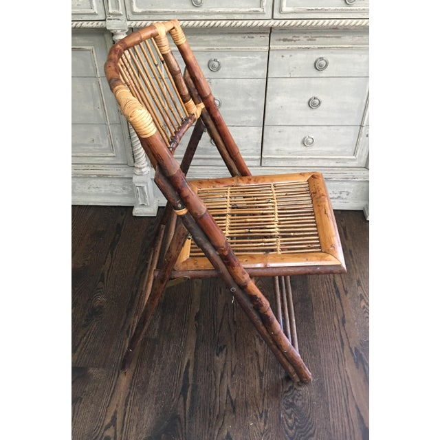 Vintage bamboo folding chair with tortoiseshell finish. Great eclectic piece for a porch, dining or as a desk chair. Folds...