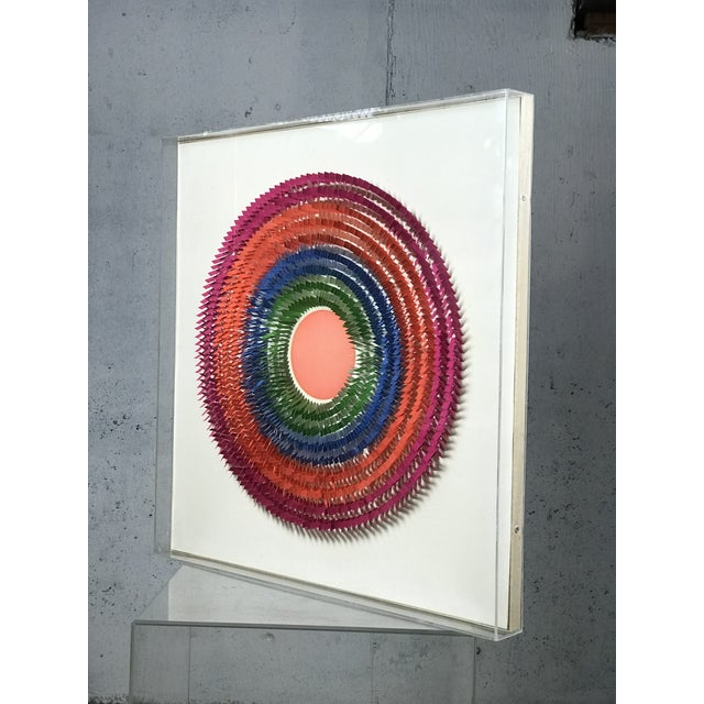 Intricate and beautiful paper sculpture by Irving Harper. Encased/framed in acrylic. From the estate of Irving Harper....
