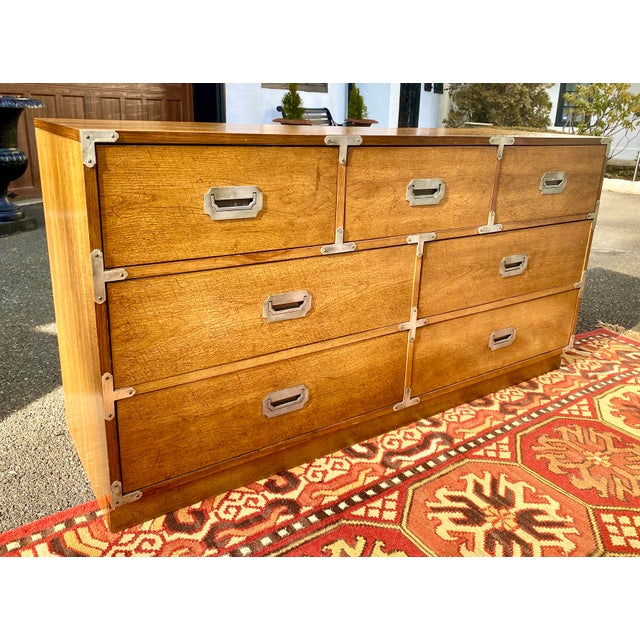 Timeless campaign dresser by Bernhardt with three small drawers above 4 larger drawers. Antiqued nickel tone hardware....