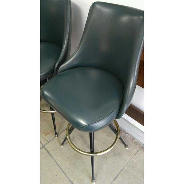 Pair of Swivel Metal and Brass Bar/Counter Stools from the 60's Perfect Conditions and Clean Bonded Leather