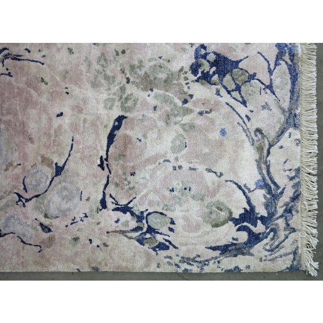 Marbleized Ginger Root Pale rug is inspired by one-of-a-kind original marbleized papers made by artist Michelle Weinberg...