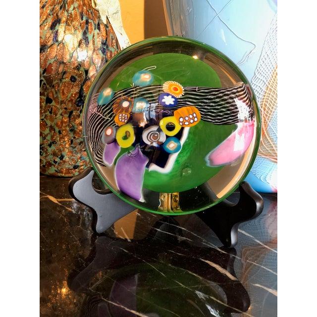Contemporary hand blown glass disk millefiori design, signed.