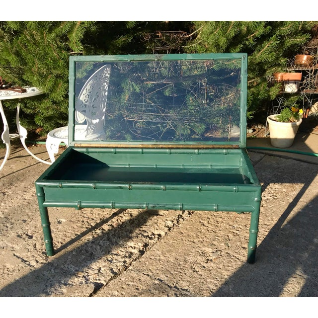 Fabulous find; Hunter green over distressed black faux-bamboo coffee table .The top lifts for a perfect display area, was...