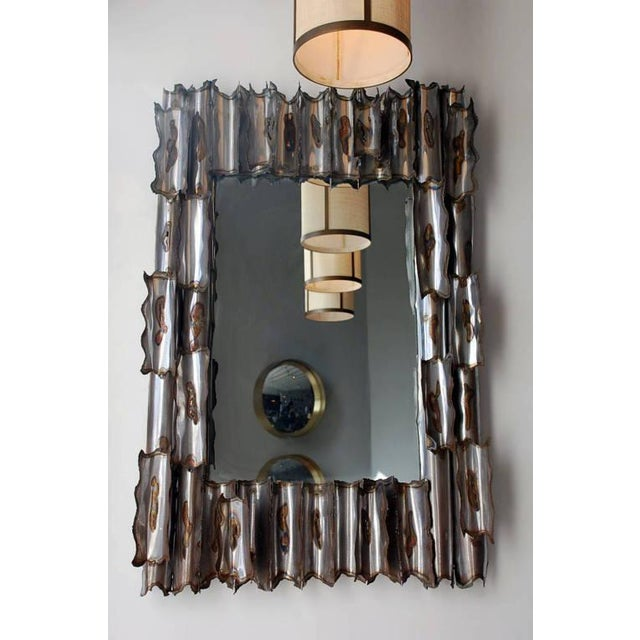 Exceptional American brutalist mirror. Signed and dated 1978.