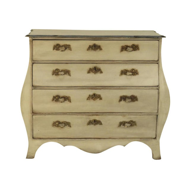 An early 19th Century Dutch painted bombe commode.