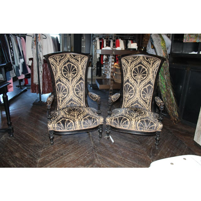 Pair of Antique Victorian high back slipper chairs with custom vintage black and tan upholstery.