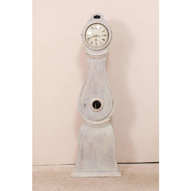 A 19th century Swedish clock. This antique clock from the central area of Sweden features a flattened arch shaped raised...
