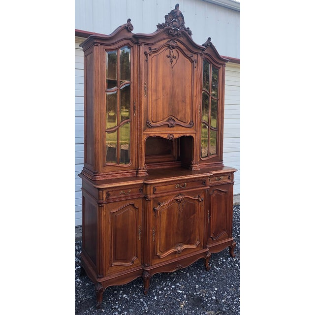 Magnificent best describes this two part hutch from the renowned cabinet shop of Haentges Fres in Paris. This rare example...