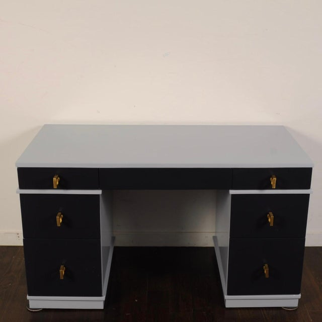 Fifties-era double pedestal, seven drawer desk restored for another 60 years. Lacquered in a light grey frame with dark...
