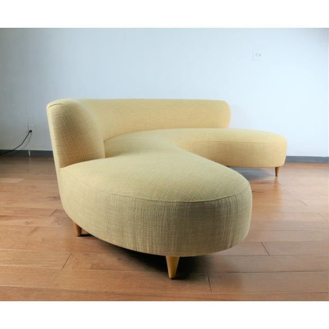 Beautiful Reupholstered light yellow serpentine style sofa in excellent condition. No damages or stains. Great vintage...