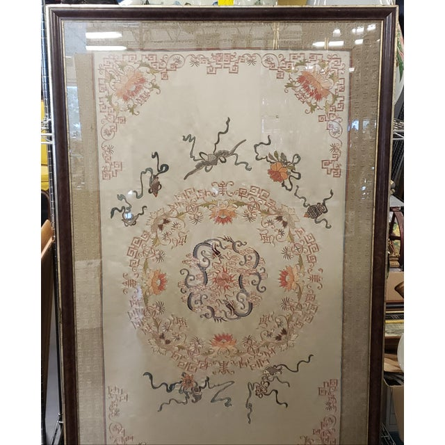 Up for sale is a massive Early 20th Century Chinese Framed Embroidered Silk Panel! The wonderful feng shui twin dragons...
