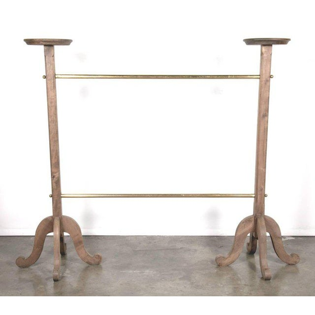 Fabulous and sophisticated 1930s two-tier polished old French brass garment rack, featuring bleached oak pedestal column...