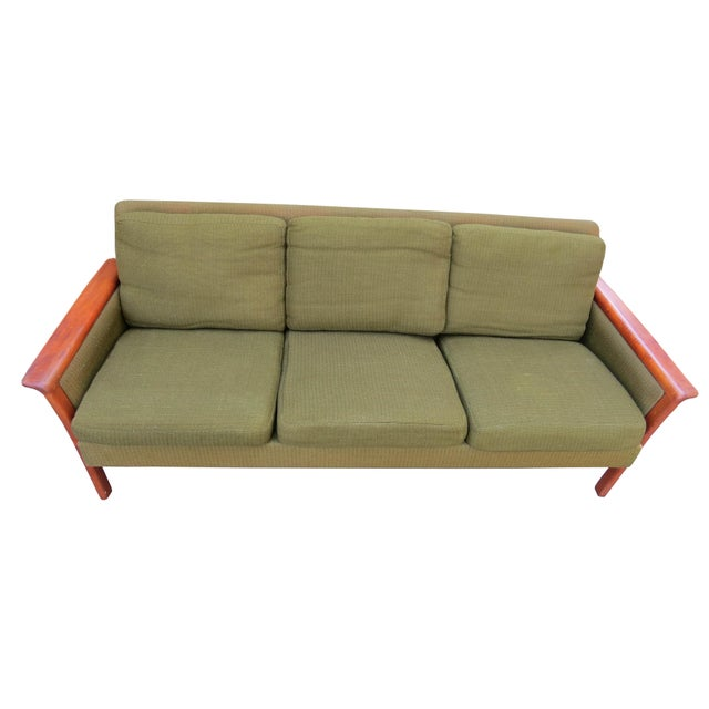 Danish mid-century modern sofa designed by Hans Olsen. The solid teak frame accentuates the original green tweed fabric....