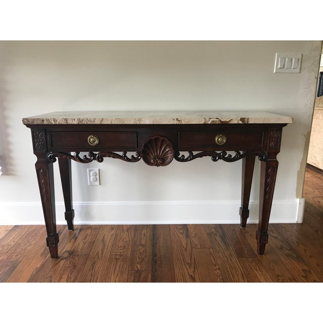 "Marble top console table from Century Furniture. The beautiful neutral colored marble top is 1.25"" thick. It boasts a..."