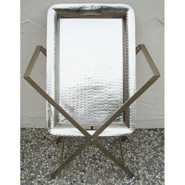 Silver Hammered Tray Table with Removable Tray. Form and function combine in this classy tray table. The tray is made from...