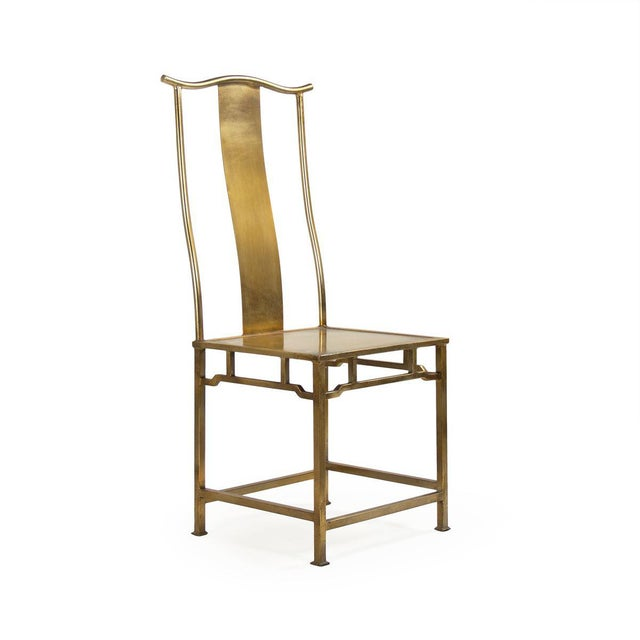 Iron side chair in antique gold finish.