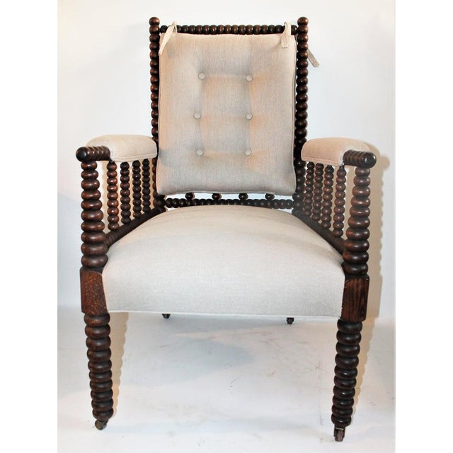 This 19th century Barley twist spool side chair is in fine condition and has a removable back cushion in linen. This chair...