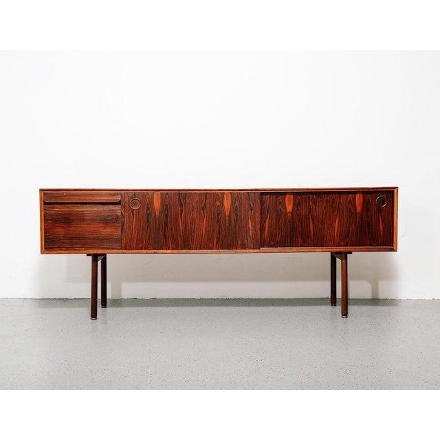 Beautiful rosewood credenza designed by Haug Snekkeri for Bruksbo Norway.