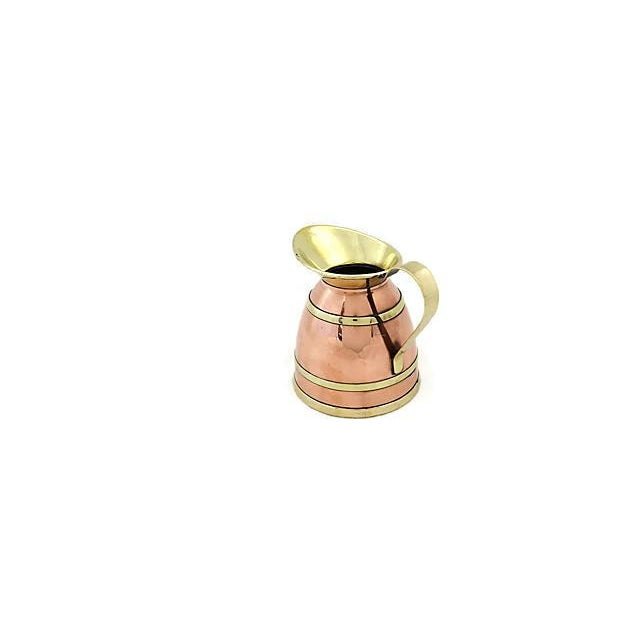 English copper jug with brass banding. Maker's mark on underside. Light wear.