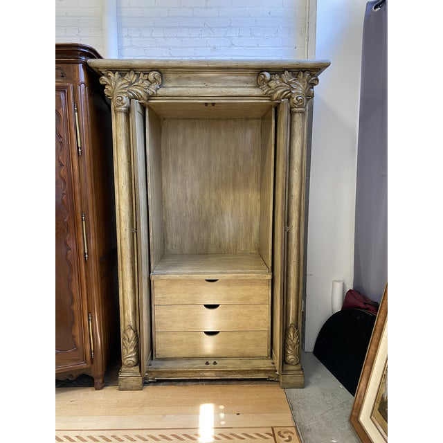Design Plus Gallery presents an Artifacts International Italian Neoclassical Armoire. Antiqued wood is given an elegant...