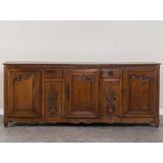 An exceptional antique French Louis XV period carved oak enfilade circa 1760 from the region of Picardy. This enfilade is...
