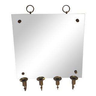 Tommi Parzinger Wall Mirror With Brass Candleholders For Sale