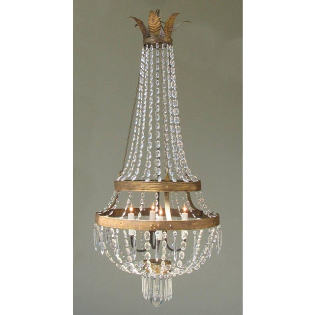 A late 18th century Italian Empire iron, tole and crystal chandelier, circa 1780, featuring gilt leaf corona and crystal...
