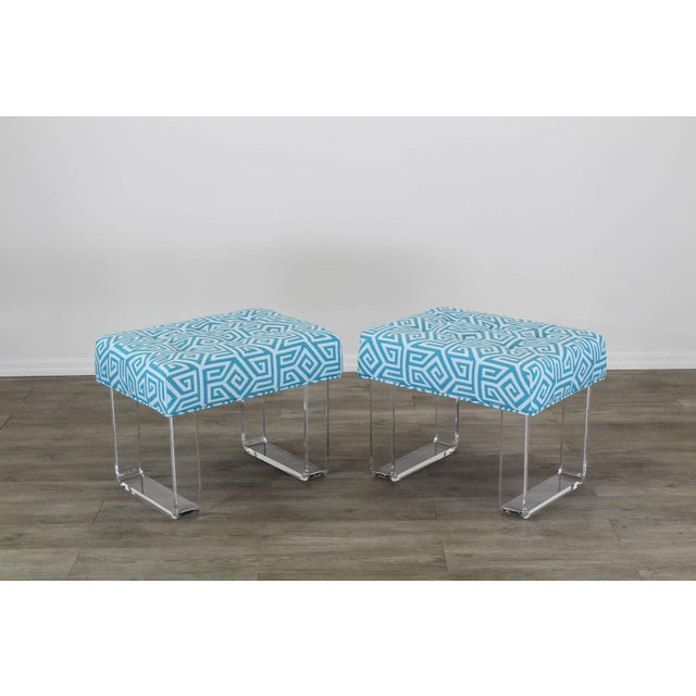 Elegant pair of custom waterfall acrylic benches with upholstered cushion in a lovely blue Greek key Textile Each acrylic...