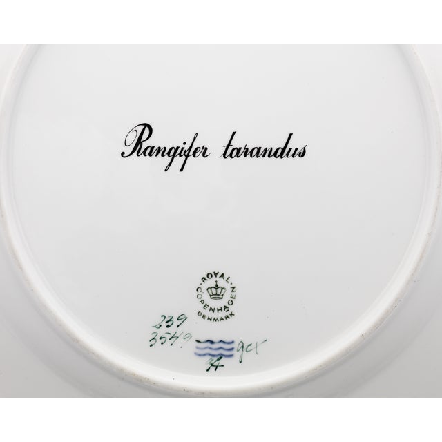 A reindeer is the star of the snowy scene on this extraordinarily rare porcelain dinner plate. Crafted by Royal...