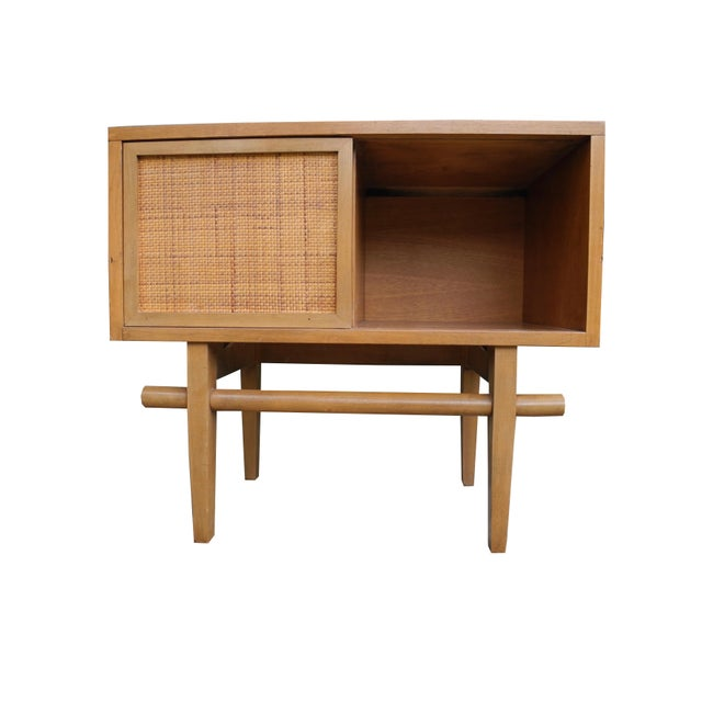 This Asian influenced modern design is made of maple. It has a sliding door with a rattan face. There is also a drawer on...