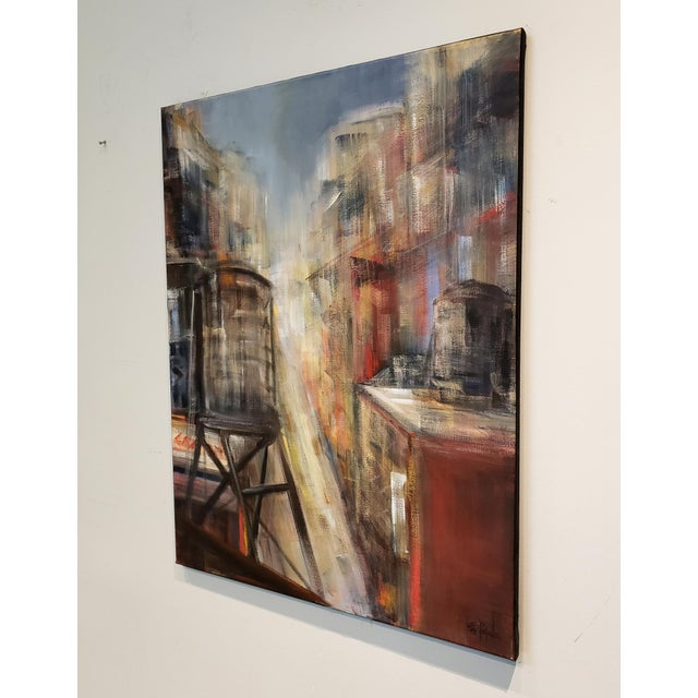 Impressionistic painting of New York City rooftops at sunset. The activity and movement of the city below and the lighting...