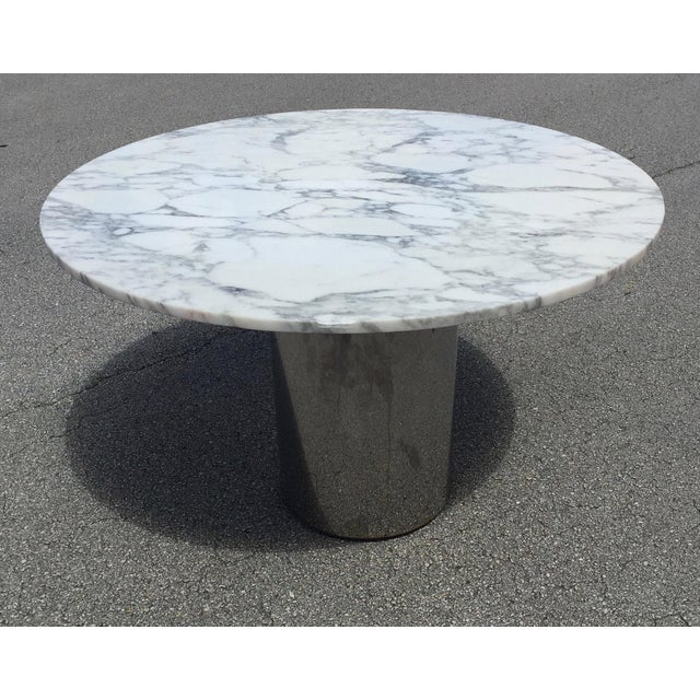 Vintage mid-century modern chrome and white marble chrome drum dining Table. Composed of white marble and gray veins...