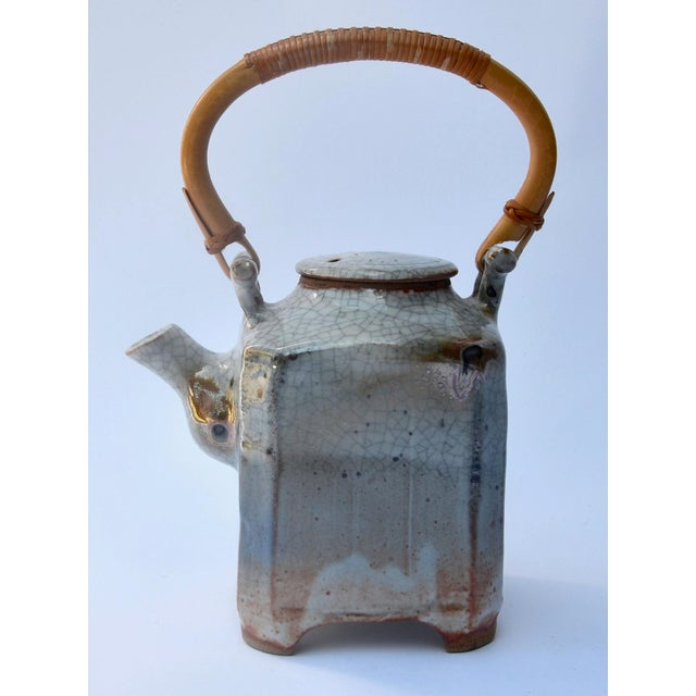 A large mid century modern beautiful artist made studio pottery, great craftsmanship and stunning glaze, with bamboo...