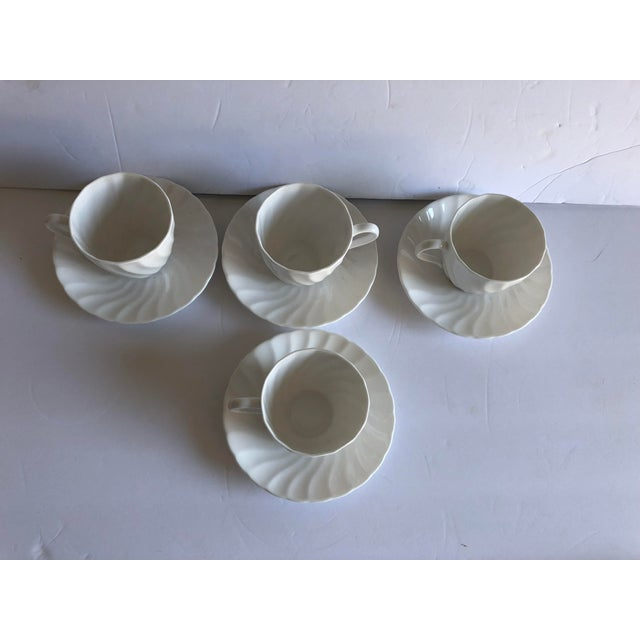 "Vintage set of 4 cocoa or teacups and saucers bone China "" makers mark reads "" Royal Tuscan, Fine Bone China Wedgwood ""..."