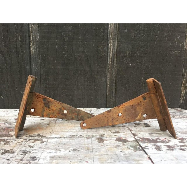 Antique, large, T-strap barn door hinges. Obvious oxidation from a lifetime spent in the elements. These hinges came off a...
