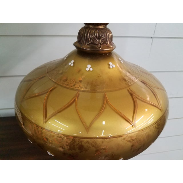 Mid century gold glass globe lamps on white marble and brass base. Made in the 1950s.