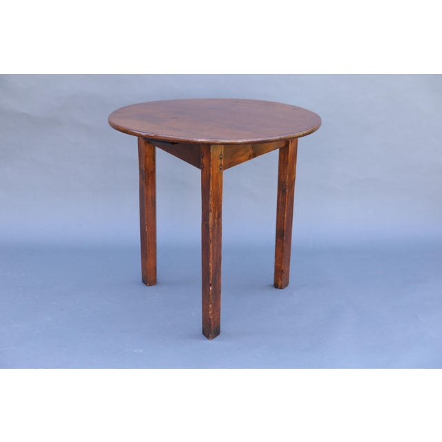 A fine early 19th-Century English Georgian period cricket table in chestnut wood. This superb table is pegged...