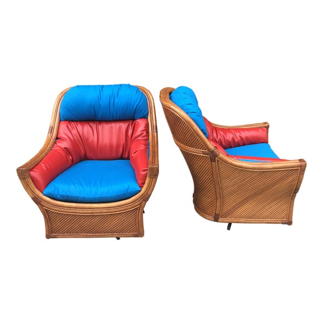 1960s Mid Century Modern Maguires Style Red and Blue Upholstered Rattan and Bamboo Outdoor Swivel Chairs - a Pair For Sale