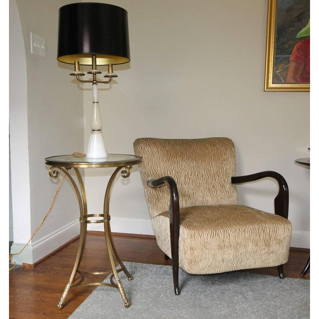 This is a taller neoclassical style round brass Gueridon side or end table with an inset bevelled glass top. Well-crafted...