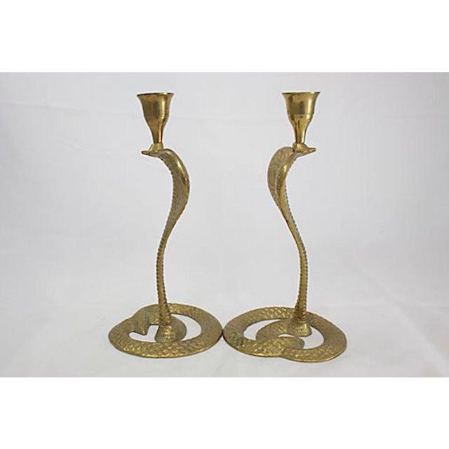 Mid-century brass cobra candlesticks, a pair. No maker's mark.