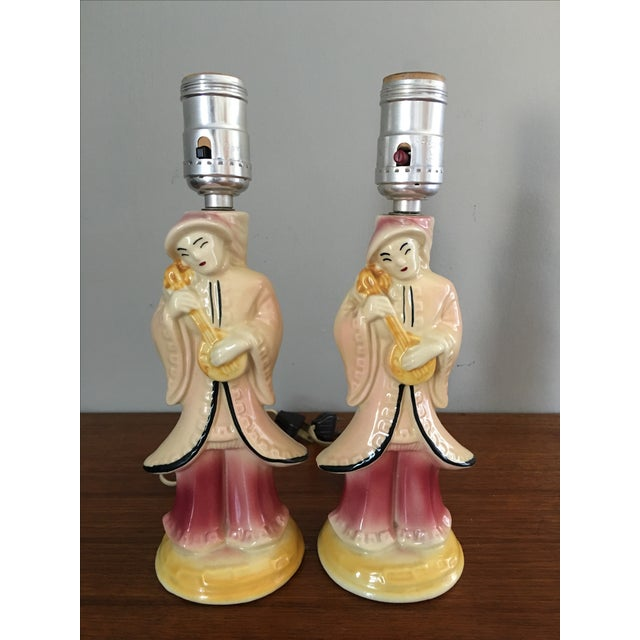 Pair of mid century Asian lamps by Shawnee Pottery. No shades.