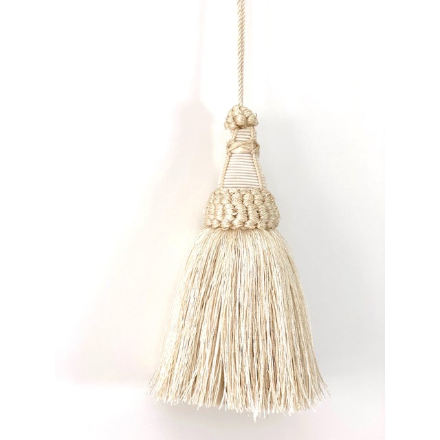 Handmade cream and white colored key tassel with looped ruche, twisted cord and full skirt. This item has a true warm...