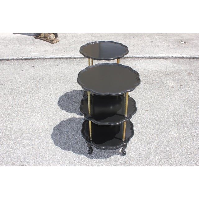 Beautiful Pair of French Louis XV Side Table Circa 1910s. three-top shelves ebonized with a French Lacquer finish...