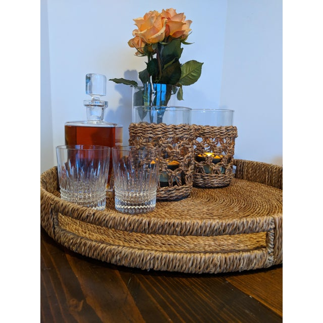 "This oversized 22"" woven tray is stately but casual. Comprised of woven natural materials and wood, this organic modern..."