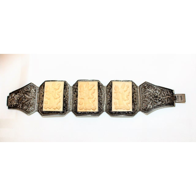 Circa 1940s Chinese sterling silver bracelet made up of five ornate mesh sections embellished with ornate sterling...